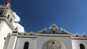 White Church gates. Gorgeous entrance gates panorama of Basilica of Our Lady of Copacabana in Bolivia stock footage