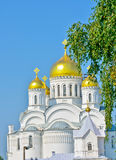 White church with golden domes stock photos