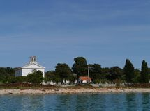 A white church on the graveyard of Olib in Croatia Stock Photography