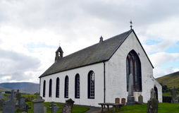 White church in Highlands, Perthshire, Scotland. Amulree Church of Scotland, Glen Quaich, Highland Perthshire, Scotland. An idyllic spot but where the local Stock Photos