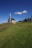 White church on a hill royalty free stock image