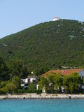 The white church on the hill of Ist. The village Ist on the island Ist in the Adriatic sea of Croatia stock images