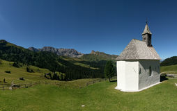 White church in hillside, Alpi di Siusi, Dolomites, Italy Royalty Free Stock Photo