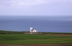 White church in serene landscape. White church on the Irish sea shore, in serene landscape stock images