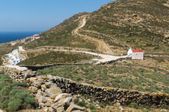 White church and panorama to Mykonos island, Greece Stock Photos
