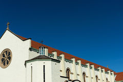 White Church red roof and Blue Sky Royalty Free Stock Image
