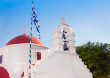 A white church with red roof at Greek town of Mykonos Royalty Free Stock Images
