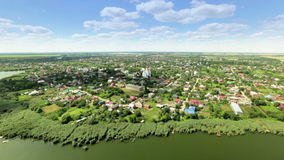 White church and river in Russian village aerial stock footage