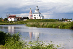 White church on a riverbank Stock Image