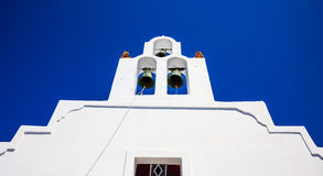 White church in Santorini Greece. Santorini, Greece - White church on blue sky background Stock Photos