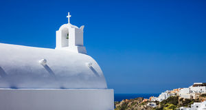 White church in Santorini Greece. Santorini, Greece - White church on blue sky background Royalty Free Stock Images