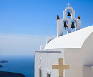 White church in Santorini, Greece. Santorini, Greece - White church and caldera view Royalty Free Stock Image