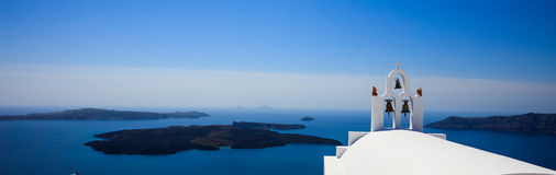 White church in Santorini, Greece. Santorini, Greece - White church and caldera view Royalty Free Stock Photography