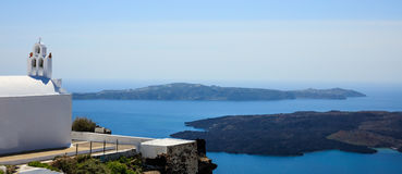 White church in Santorini, Greece. Santorini, Greece - White church and caldera view Royalty Free Stock Images