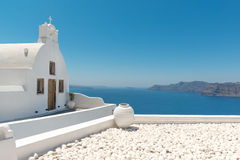 White church. Small traditional Greek Orthodox church in Oia, Santorini Stock Photos