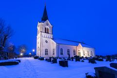 White church in small village of Sweden. At night Stock Images