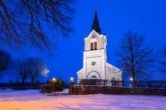 White church in small village of Sweden. At night Stock Photos