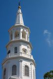 White Church Steeple And Clock Tower Stock Photo