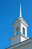 White Church Steeple Set Against a Cloudless Blue Sky Stock Image