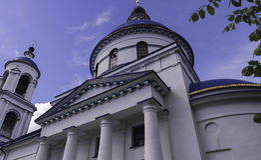 White Church. White stone Church with a high belfry Stock Photos