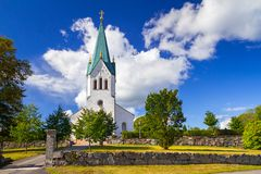 White church in Sweden. White church over sunny blue sky in Sweden Stock Photography