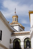 White church tower in Seville Stock Photo