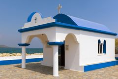White church in traditional Greek colors on Rhodes island, Greece Stock Photos