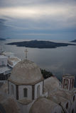 White church and a view of the Caldera of Santorini Royalty Free Stock Images