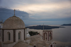 White church and a view of the Caldera of Santorini Stock Photography