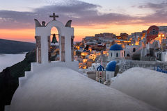 White Churches of Oia Village at Sunset, Santorini, Greece Royalty Free Stock Images