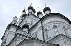 White churh. Towers of white orthodox churh Royalty Free Stock Photo