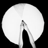 White Circle. Broken glass Hands Shallow depth of field Toned BW Royalty Free Stock Photography