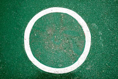 White Circle color paint on green floor background Royalty Free Stock Images