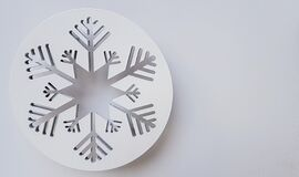 White Circle with decoration of snow flakes for Christmas greetings