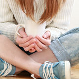 White circle in the hands of a girl Stock Image