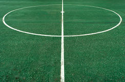 White circle line at center of football pitch Royalty Free Stock Photo