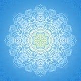 White circle ornament on blue backdrop. Royalty Free Stock Photos