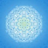 White circle ornament on blue backdrop. Royalty Free Stock Photo