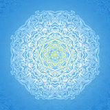 White circle ornament on blue backdrop. Royalty Free Stock Photography