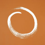 White circle painted on orange background Stock Photos