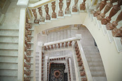 White circular marble staircase with brown stand Royalty Free Stock Image
