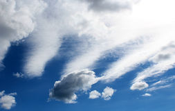 White cirrostratus clouds in blue Australian autumn sky. Stock Images