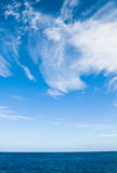 Cirrus clouds against a blue sky Stock Image