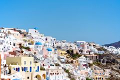 White City. Above the blue sea abyss is located on a hillside town. This city is like a fairy tale. Small streets, quaint houses and multi-colored walls created Royalty Free Stock Photos