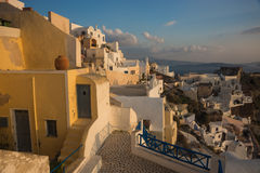 White city on a slope of a hill at sunset, Oia, Santorini, Greec Stock Photo