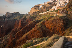 White city on a slope of a hill at sunset, Oia, Santorini, Greec Royalty Free Stock Photo