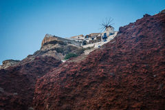 White city on a slope of a hill at sunset, Oia, Santorini, Greec Stock Image