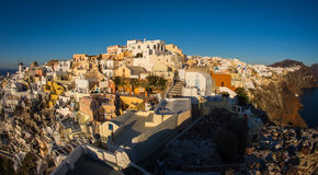 White city on  slope of  hill at sunset, Oia, Santorini Royalty Free Stock Photo
