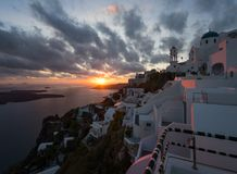 Old streets of ancient cities of the Greek white city of Santorini. White city of Tire. Sunset on the island of Santorini. Greece. Old streets of ancient cities stock photography