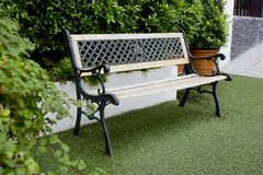 White classic bench in the garden Stock Photo